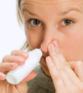 photolibrary_photo_of_woman_inhaling_nasal_spray