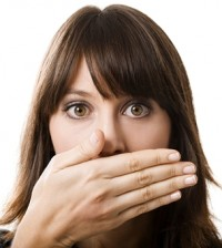 girl-covering-mouth