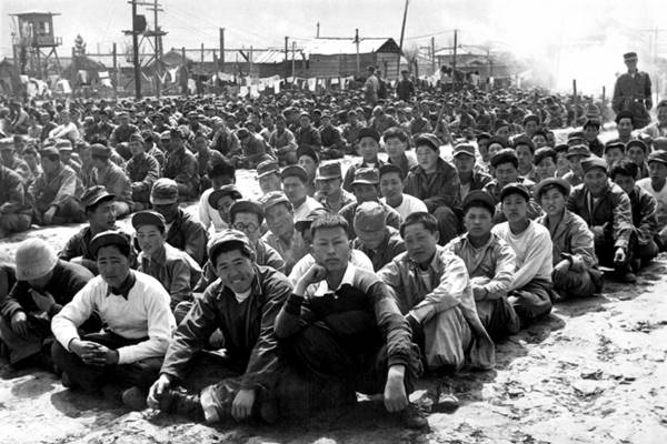 chinese_and_north_korean_pows_at_camp_in_pusan_hd-sn-99-03155